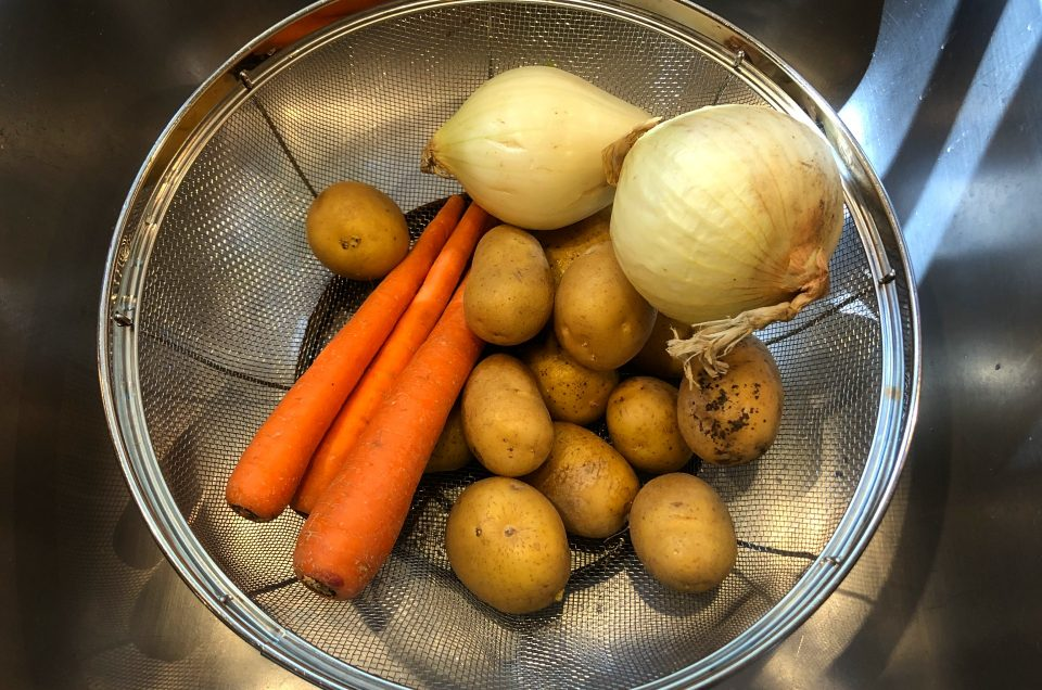 Colander full of vegetables used in many English recipes